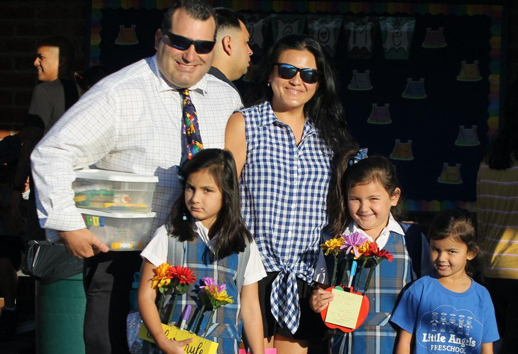 Family taking a school tour