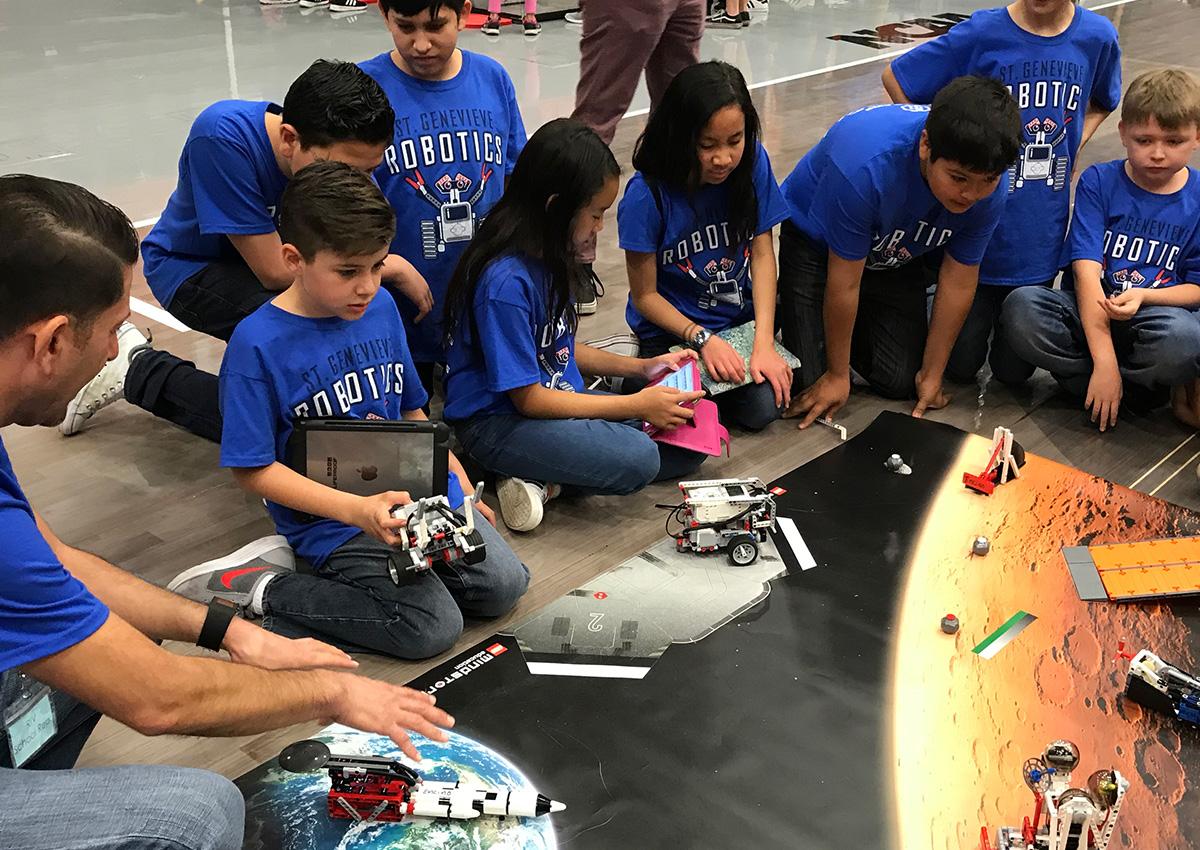 Fifth grade students exploring robots