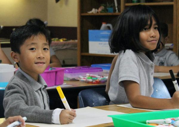 Second grade students doing class work