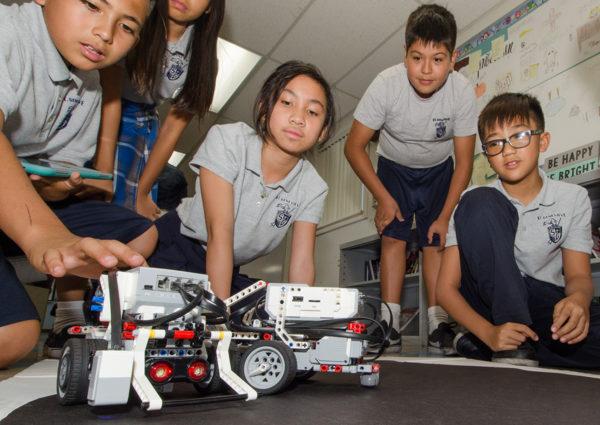 Sixth grade students learning robotics