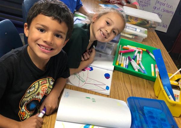 Third graders working on their artwork
