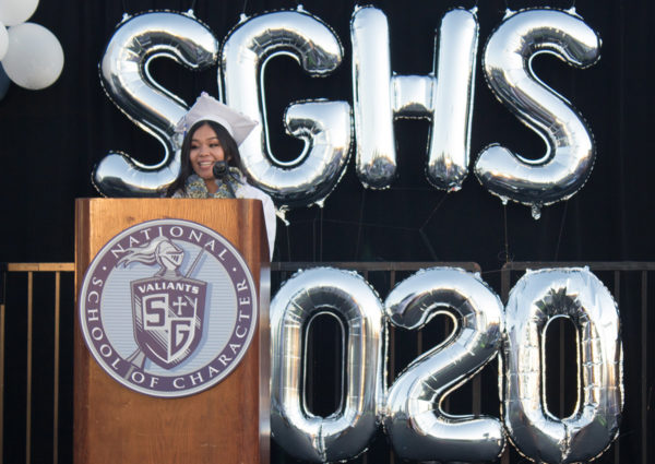 2020 graduate on stage giving a speech
