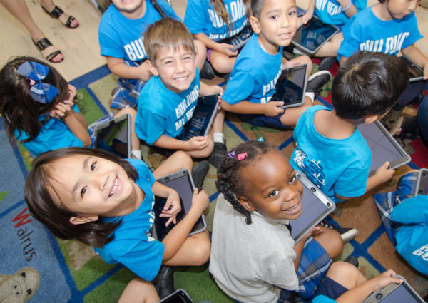 Little Angels students on their tablets