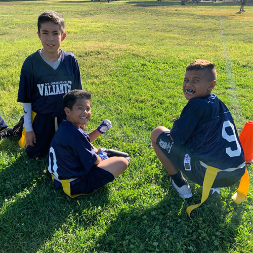 Boys playing flag football on the field