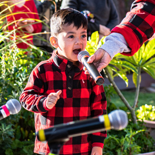Little Angels Christmas Performance boy rocking out