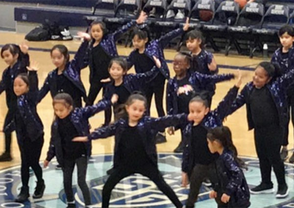 The dance team performing